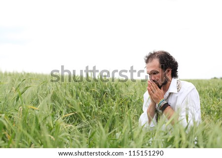 Man praying for good wheat year