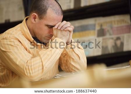 Man Praying In Library - stock photo