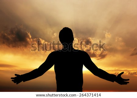 Man praying, meditating in harmony and peace at sunset. Religion, spirituality, prayer, peace. - stock photo