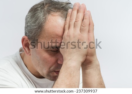 Man Praying With Hands Closed