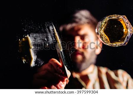 Man preparing a line of cocaine  - stock photo