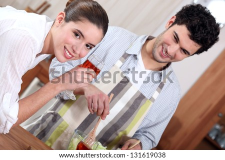 Man preparing a meal for his girlfriend - stock photo
