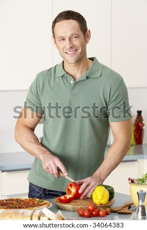 Man Preparing Meal In Kitchen - stock photo