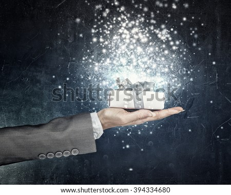 Man presenting his gift - stock photo
