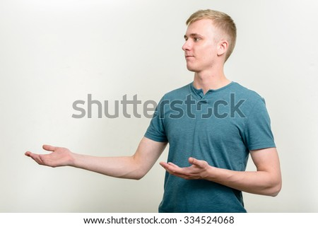 Man presenting horizontal studio shot - stock photo