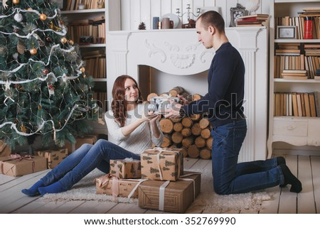 man presents gift to girl and she is happy