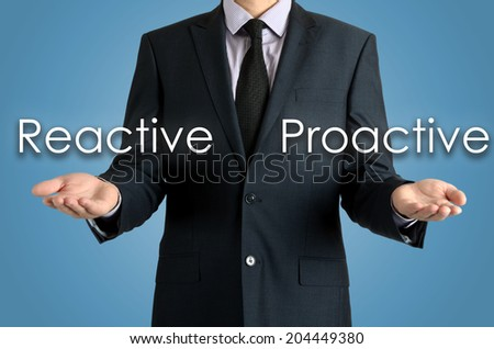 man presents with their hands for a decision problem between reactive or proactive on blue background - stock photo