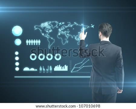 man pressing a touchscreen communication  button - stock photo