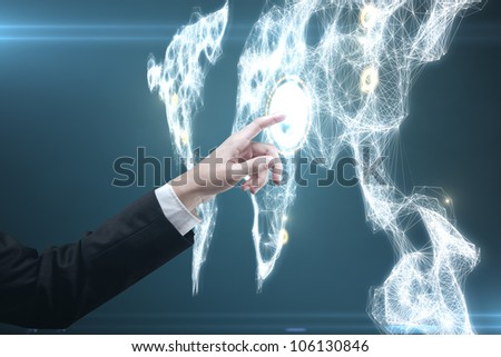 man pressing a touchscreen global communications button