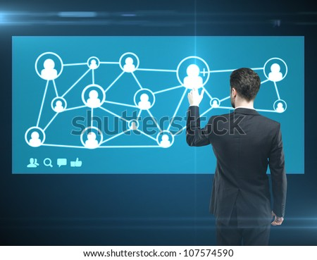 man pressing a touchscreen social media network button - stock photo