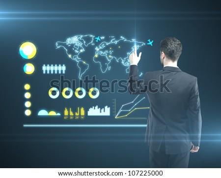 man pressing a touchscreen Social Network button - stock photo