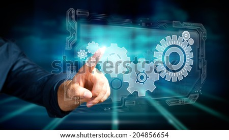 man pressing a virtual interface to control a system - stock photo