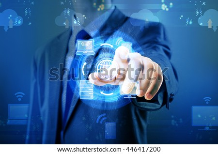 Man pressing buttons in cloud computing concept
