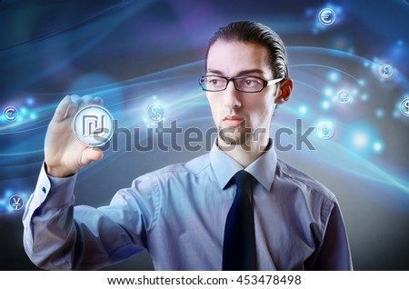 Man pressing buttons with israeli shekel - stock photo