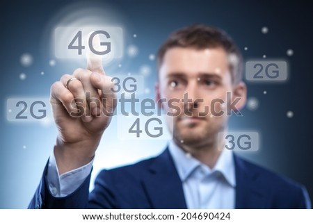 man pressing 4g touchscreen button - stock photo