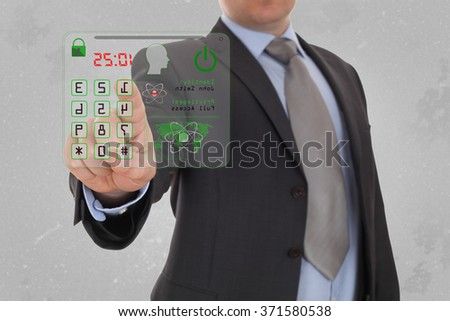 Man pressing the security code.  - stock photo