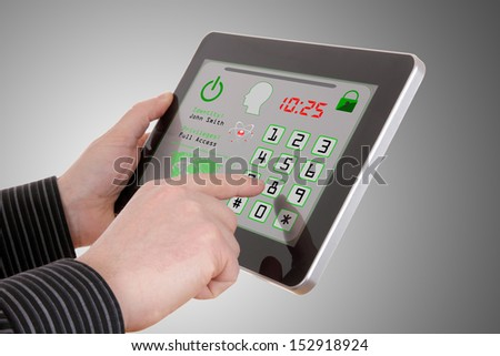 Man pressing the security code in tablet  - stock photo