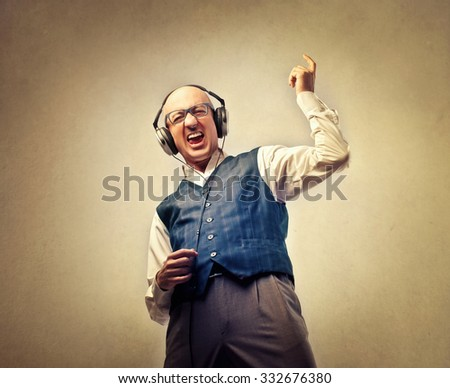 Man pretending to be playing an instrument while listening to music - stock photo