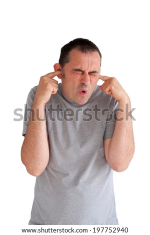 man preventing hearing damage by blocking ears from a loud noise  - stock photo