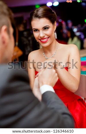 Man proposing girl, excited young woman looking at him - stock photo