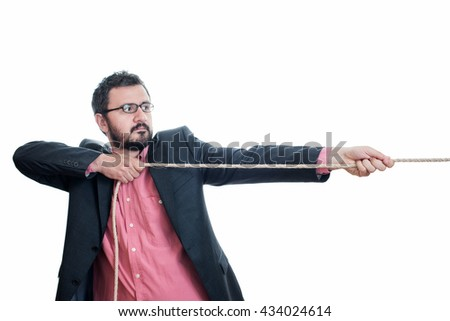 Man pulling a rope tug - stock photo