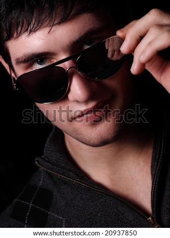 Man pulling down his shades - stock photo