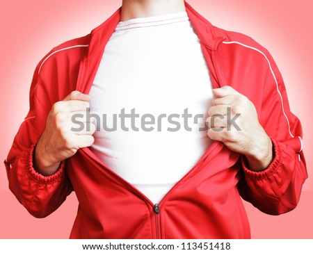 man pulling open shirt showing white t shirt - stock photo