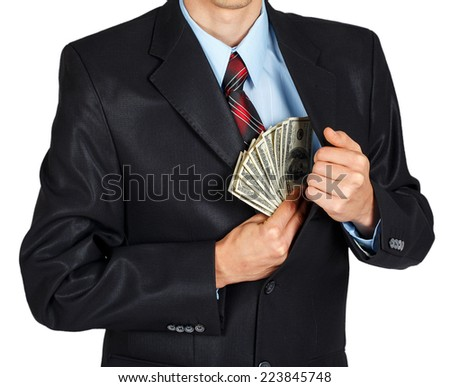 Man pulls money out of his jacket on a white background - stock photo