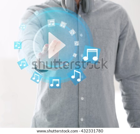 Man push play button on touch screen - stock photo