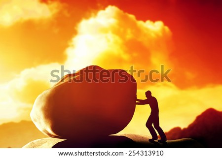 Man pushing a giant, heavy stone, rock over the mountain. Conceptual, struggle, difficult task. - stock photo