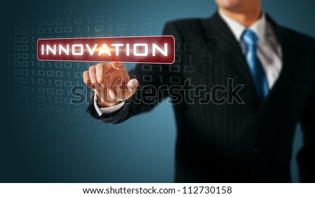 Man pushing on a touch screen interface. Innovation - stock photo