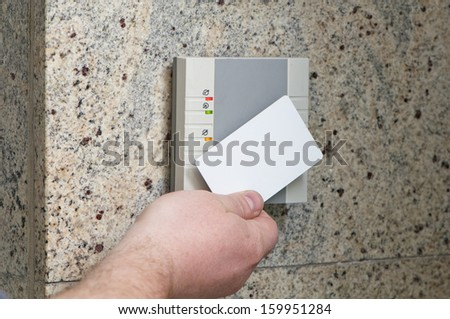 man puts the card into the reader access - stock photo