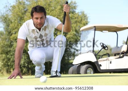 Man putting - stock photo