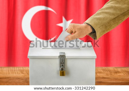 Man putting a ballot into a voting box - Turkey - stock photo