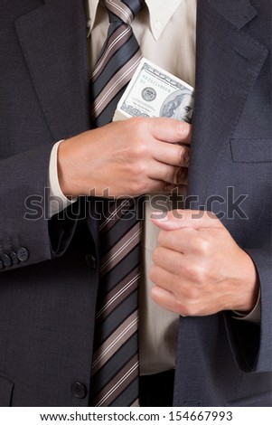 man putting dollars pack into pocket