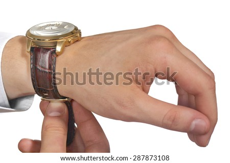 Man putting on wrist watch. Isolated on white background, shallow focus.