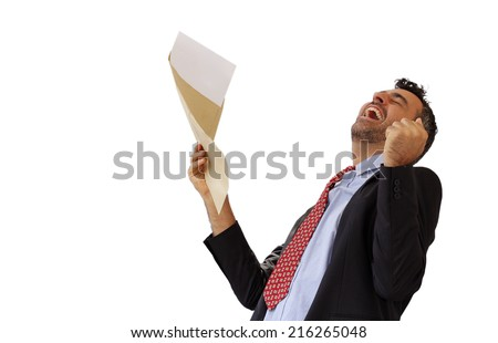 Man reacting with jubilation to a letter punching the air with his fist and cheering at his success, isolated on white - stock photo