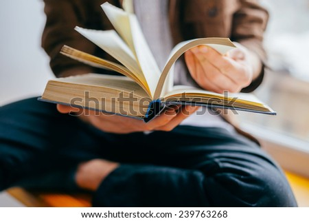 man reading a book - stock photo