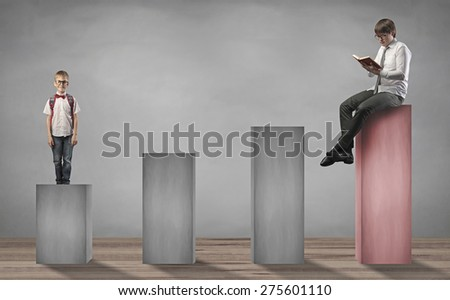man reading a book and little boy standing on lower stage - stock photo