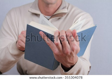 Man reading a book close up.