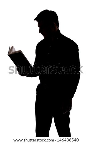 Man reading a book in silhouette and isolated on White background - stock photo