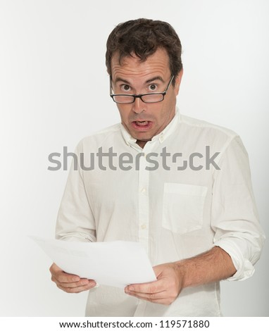 Man reading a document with an scared expression