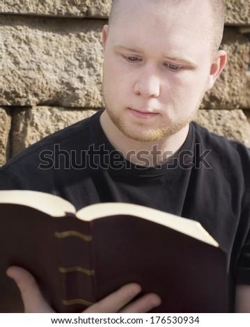 Man Reading Bible - stock photo
