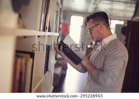 Man reading book in startup office