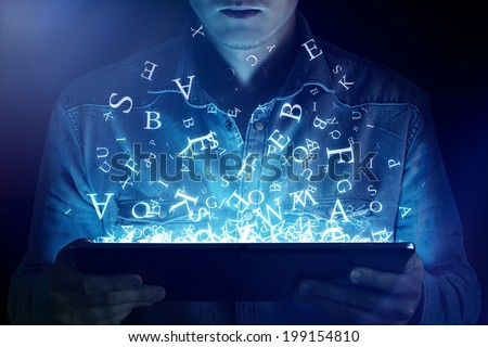 Man reading on an ebook reader - stock photo