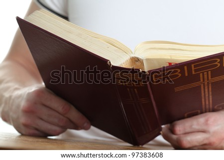 Man reading the Bible. Focus on the Bible - stock photo