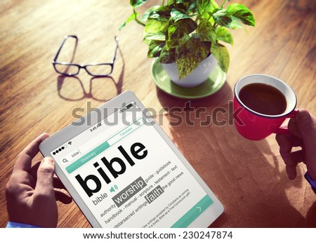 Man Reading the Definition of Bible - stock photo