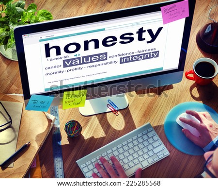 Man Reading the Definition of Honesty - stock photo
