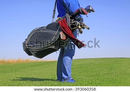 man ready to play golf, closeup of photo - stock photo