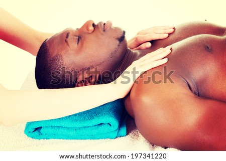 Man receiving massage at spa saloon - stock photo